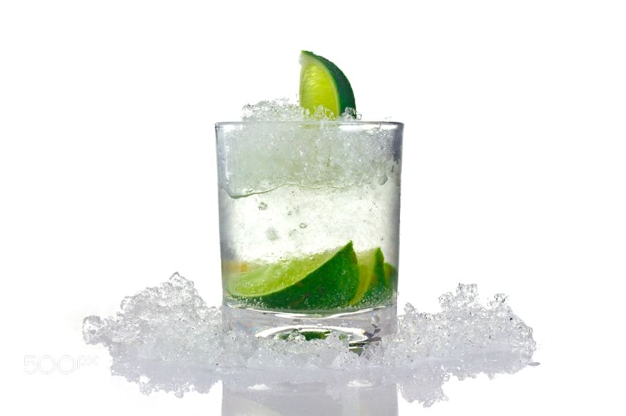 Cocktail by rap75 from http://500px.com/photo/201141301 - Cocktail with lime and ice in a glass on a white background for isolation. More on dokonow.com.