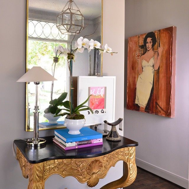 Captivating Eclectic Foyer Features An Ornate Gold And Black French Console Table Under  A Gold Framed Mirror