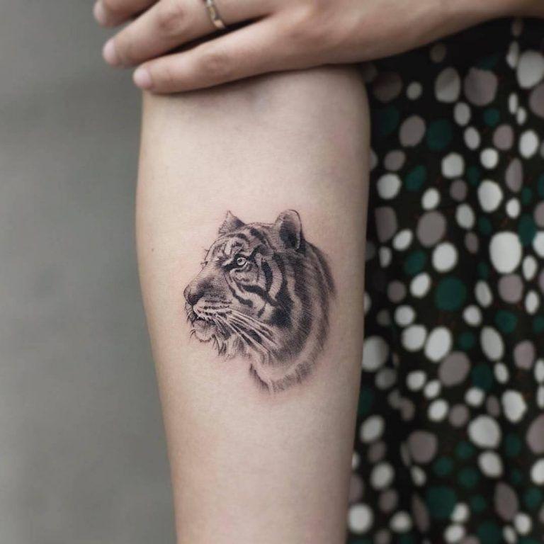 15 Small Tiger Tattoo Designs And Ideas Petpress In 2020 Tiger Tattoo Design Tiger Tattoo Tiger Tattoo Small