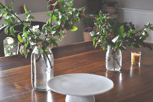 cutting lilacs and apple blossom stems  via Kate Uhry