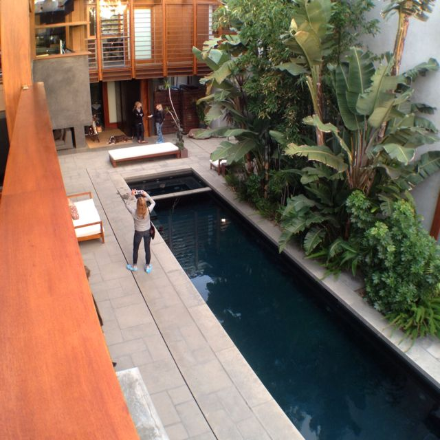Architect David Hertz's home in Venice, CA: view from the office balcony down to the courtyard and lap pool.