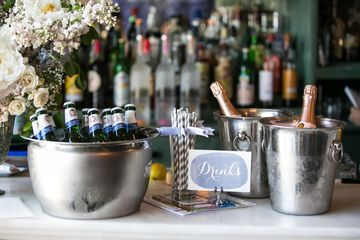 Make sure to offer a variety of beverages that appeal to teetotalers and drinkers alike. Though the mom-to-be may be sticking to festive mocktails, be sure to keep the bar or ice buckets filled with beer and bubbly for the rest of the party crowd. Placing bottles in silver buckets with some on-theme decor makes it easy for guests to serve themselves while maintaining a special vibe.