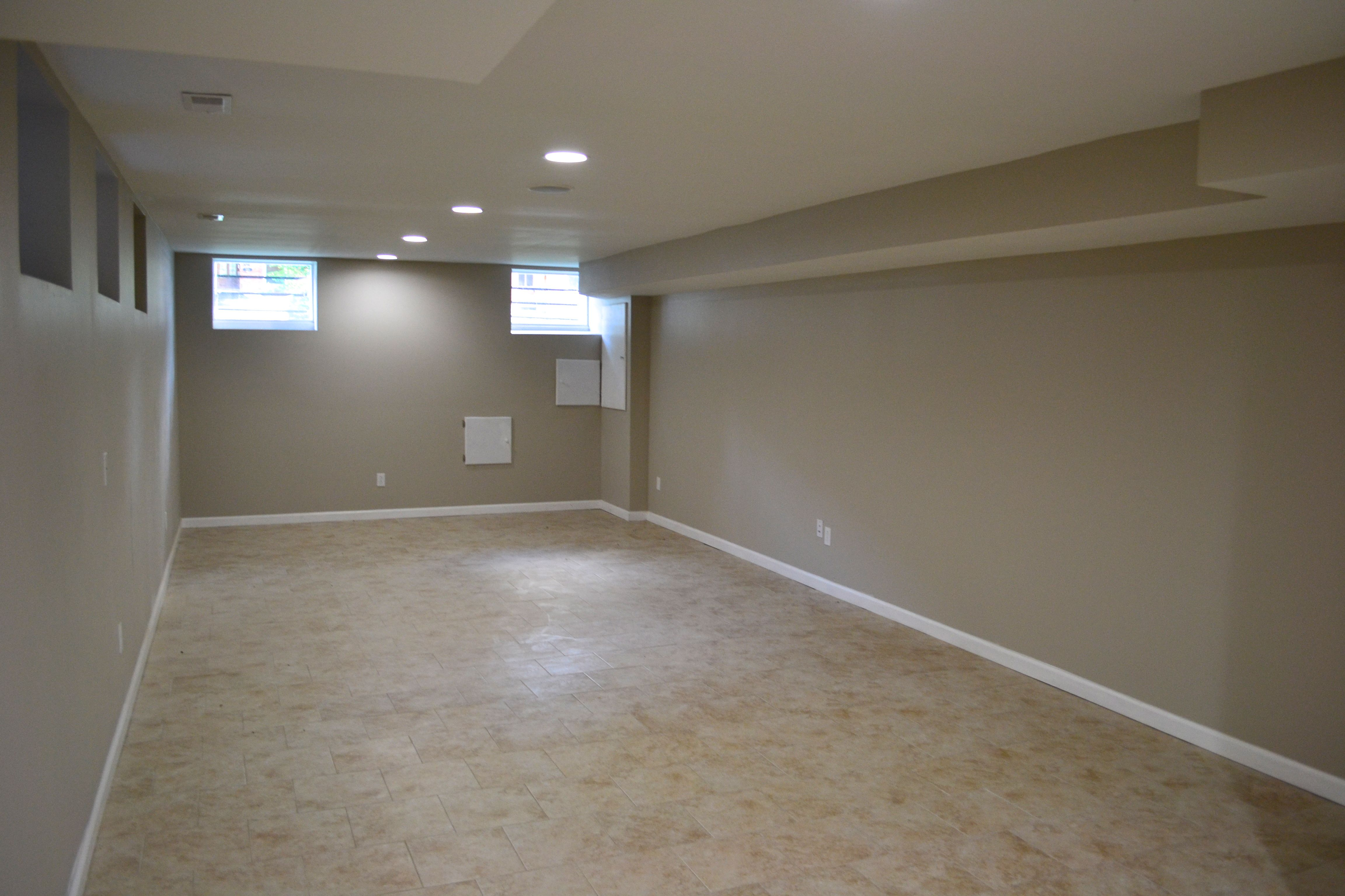 Empty Finished Basement Perfect For Playroom With Carpet