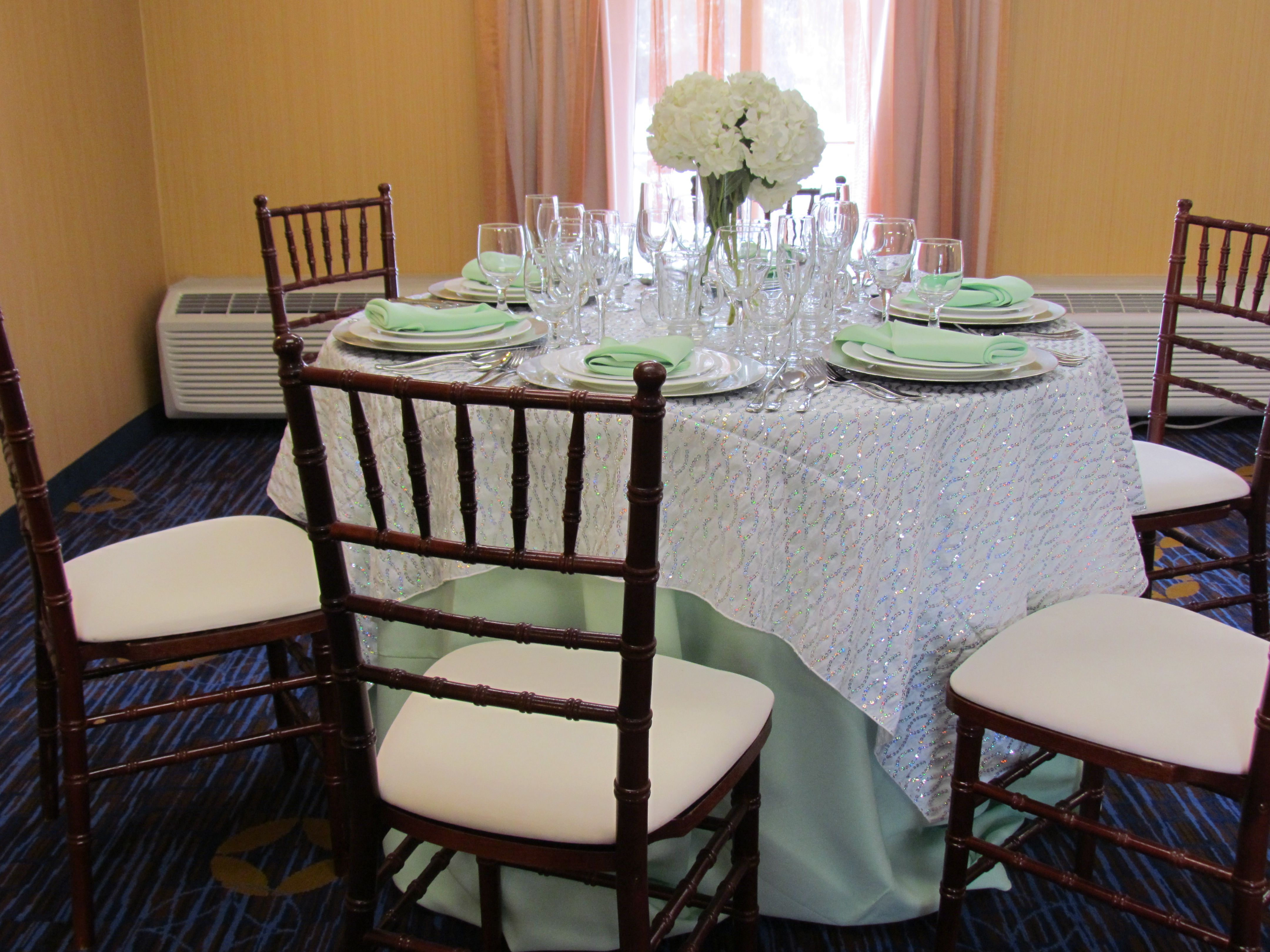 """Another 48"""" round table set up with a mint green 108"""" linen and"""