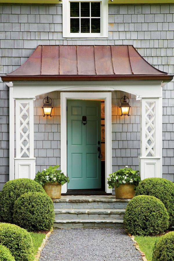 A Swooped Copper Roof And Bluestone Stoop Add Prominence To The Cottageu0027s  Entrance. White Lattice