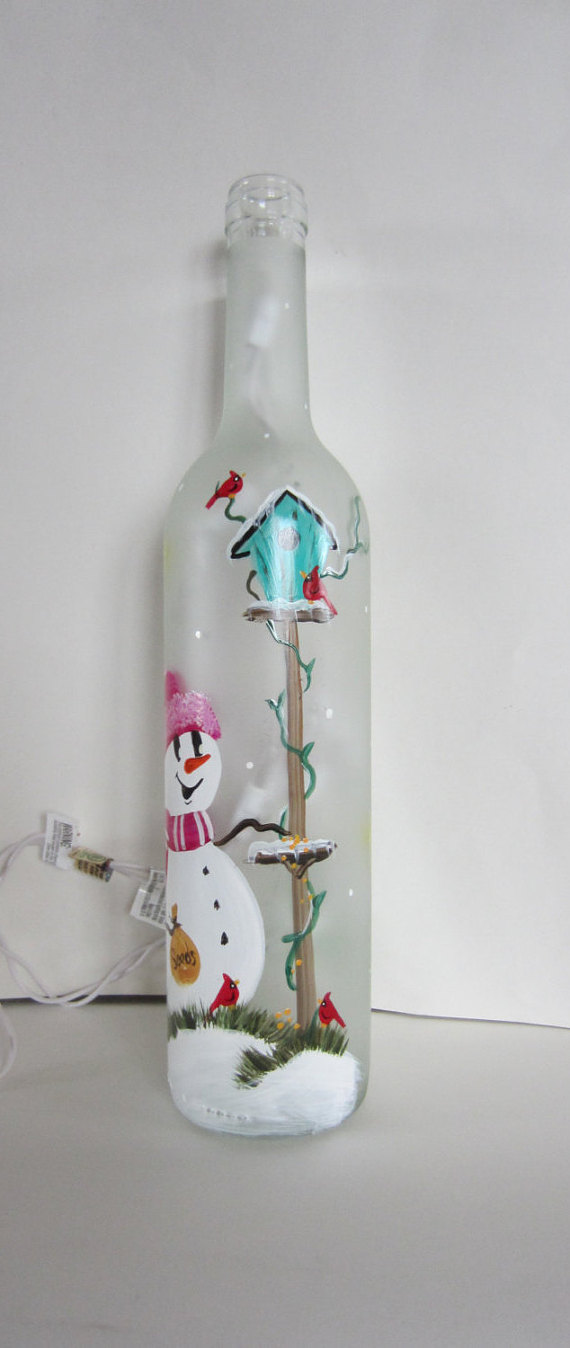 Frosted Lighted Bottle With a Snowman At