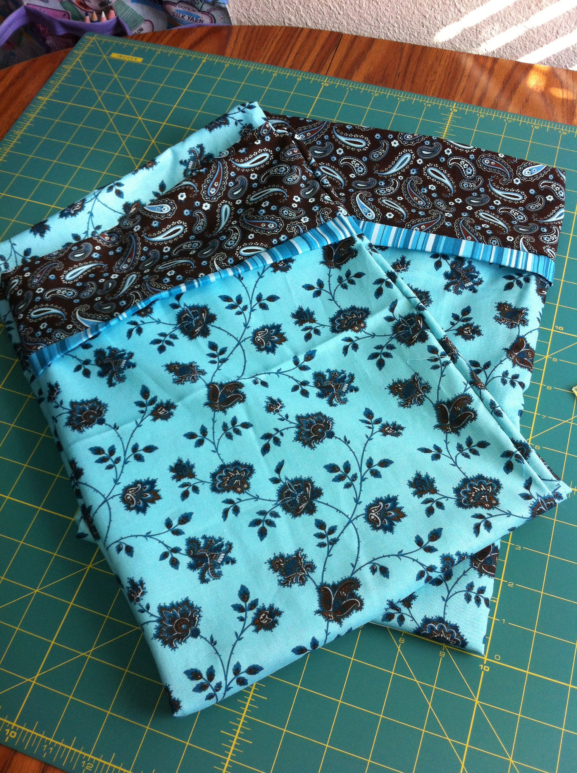 Turquoise and brown pillowcases