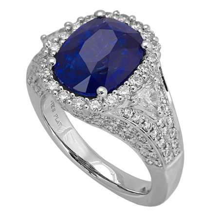 RB25252: Made in platinum, this ring holds a striking sapphire with a total weight of 4.87ct. It also features some of our finest premium cut brilliants - 1.6ct round diamonds and 0.22ct trillion cut diamonds for a flawless finish.