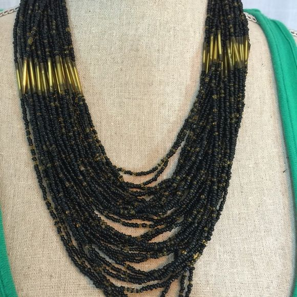 """Gorgeous multi strand beaded necklace Gorgeous multi strand beaded necklace. The shortest strand lays at 9"""" and the longest strand at 12"""".   #lisamariesvibe #beadednecklace Jewelry Necklaces"""
