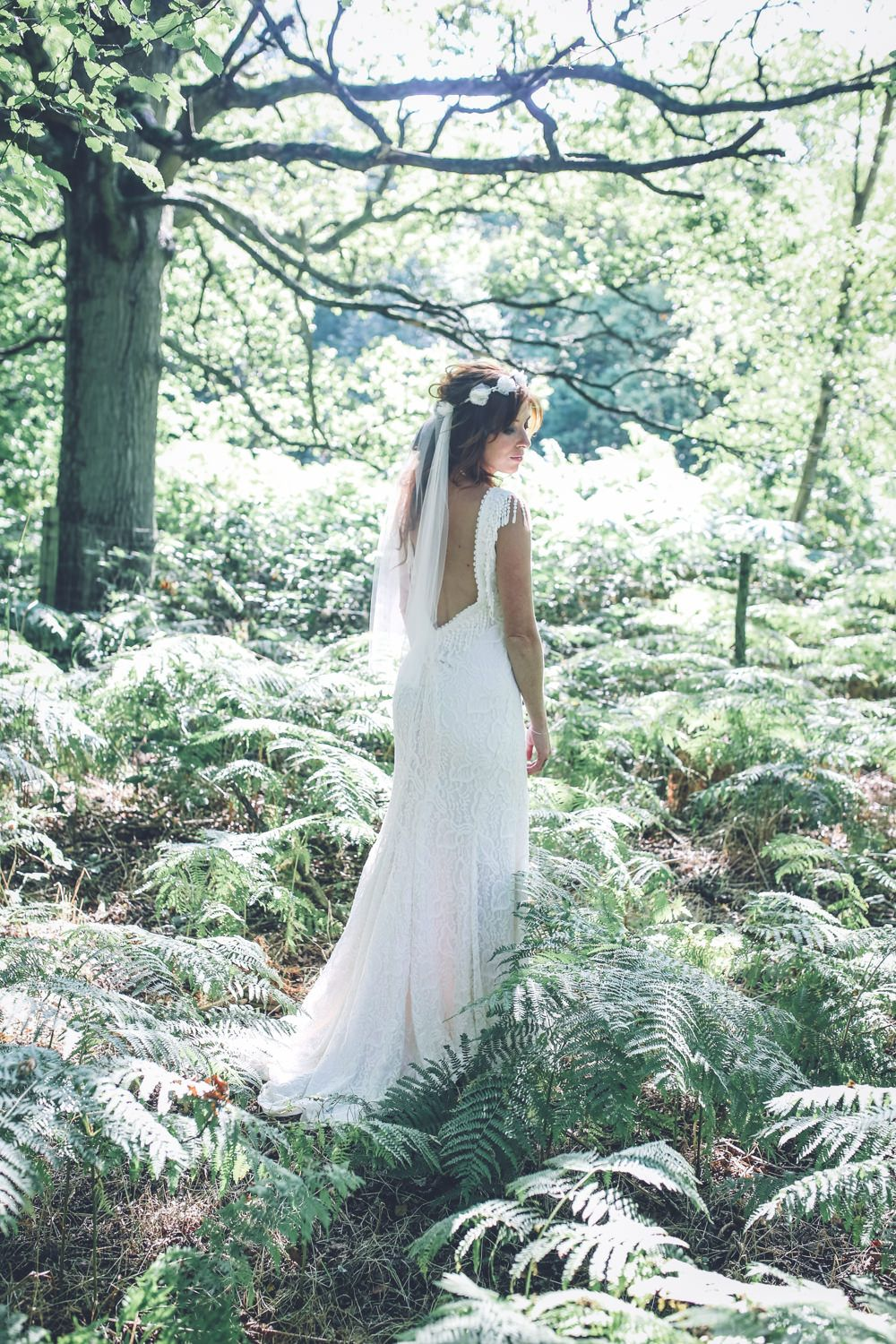All white bohemian outdoor country wedding in kent with bride in