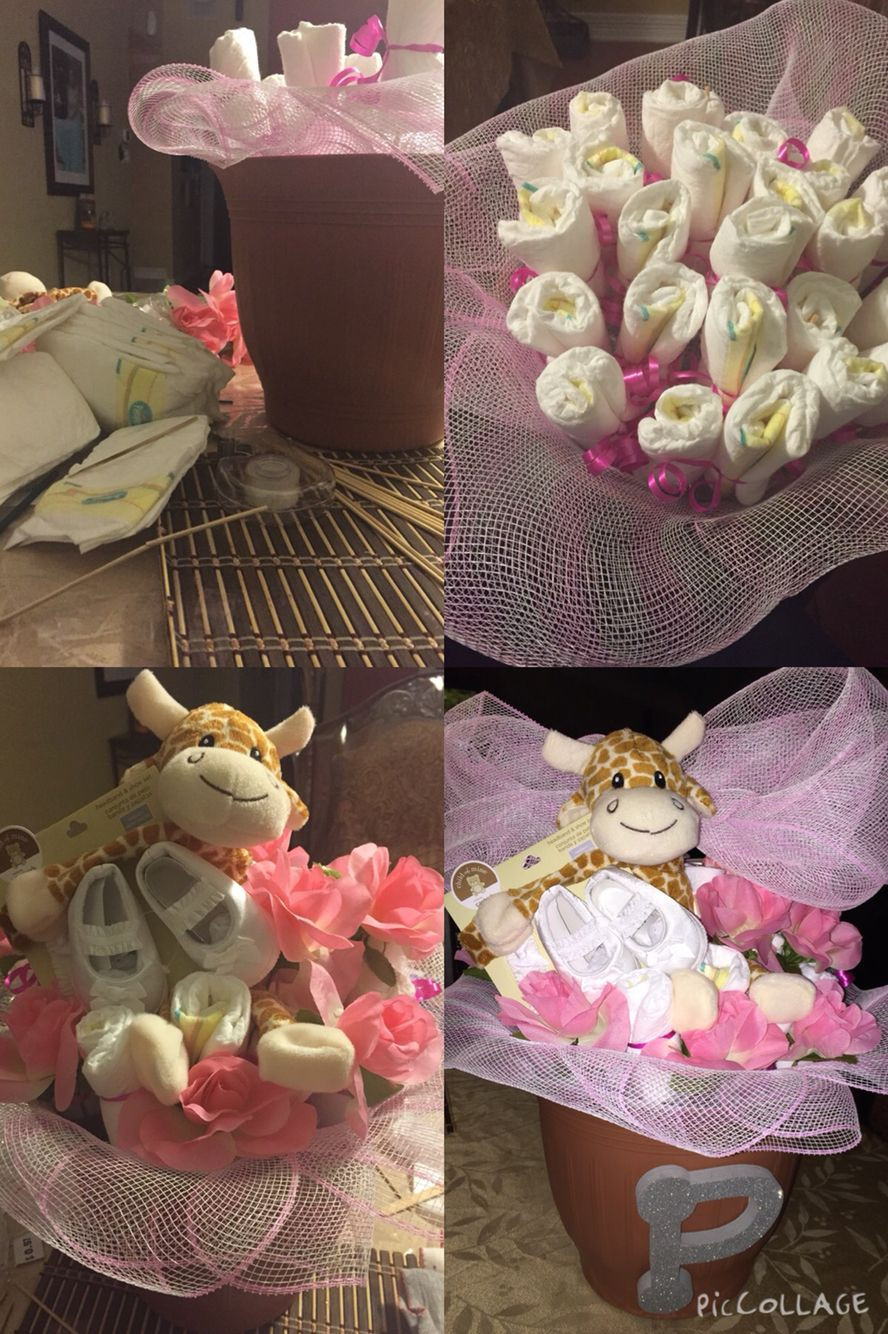 Flower pot diaper-ness, super easy and such a cute idea for a baby shower gift!!  All you need it a pot, sticks, diapers, eat.