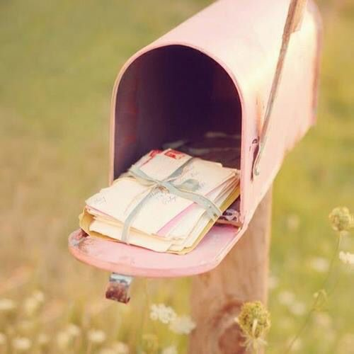 Pink mailbox & collection of letters