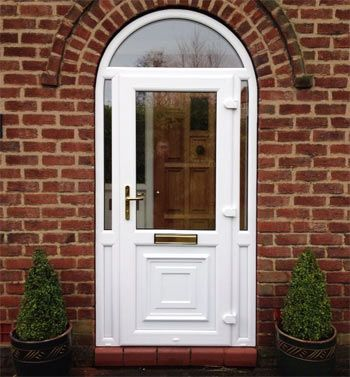 A Upvc Front Door With Arched Window Above Upvc Doors In