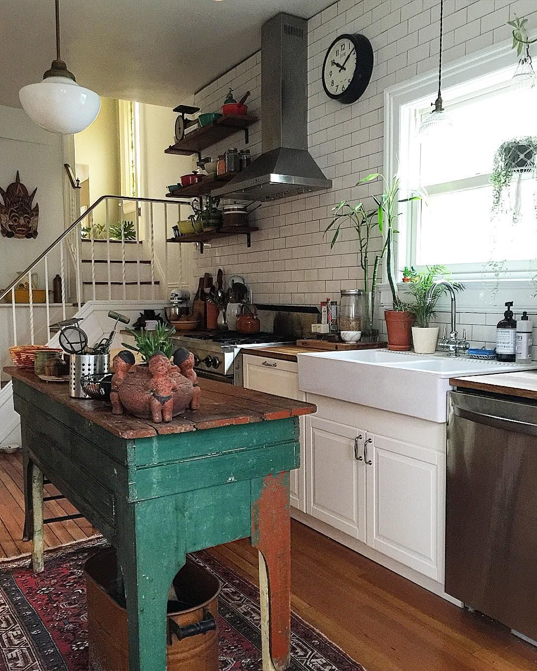 classic white kitchen gets a pop of color with green island bright rug and open shelves on boho chic kitchen table ideas id=59564