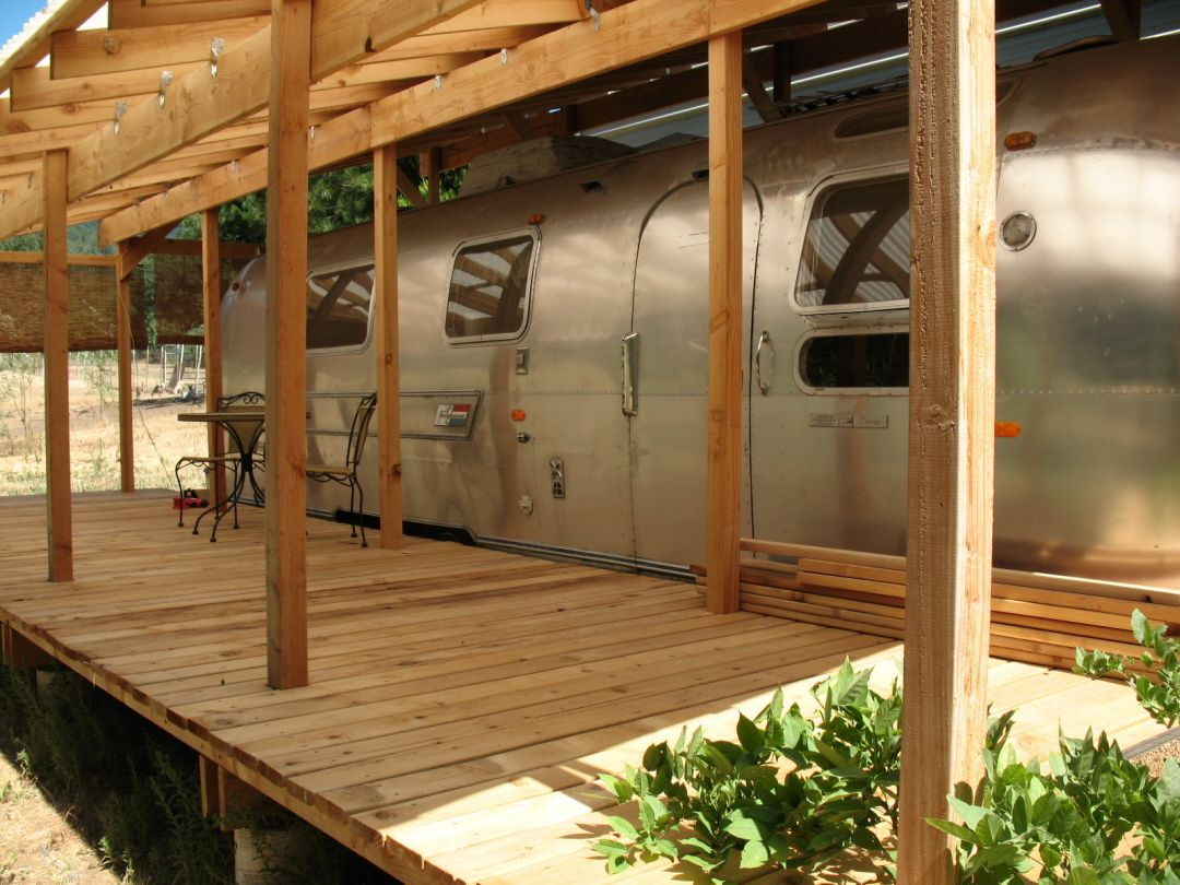 Drive under roof with porch for airstream airstream for Rv with roof deck