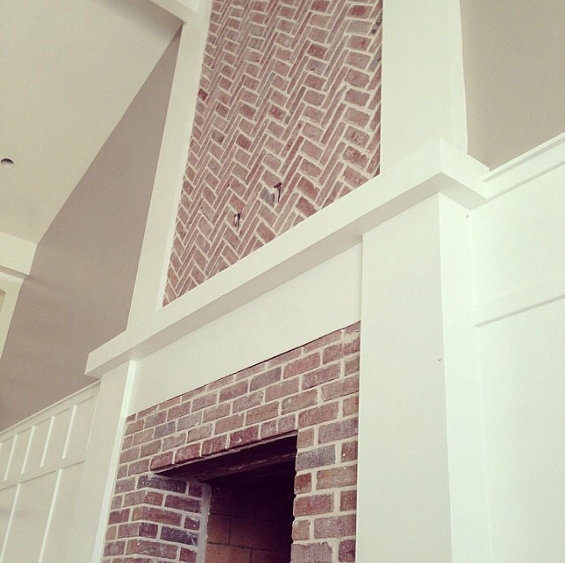 Herringbone Brick Fireplace design.