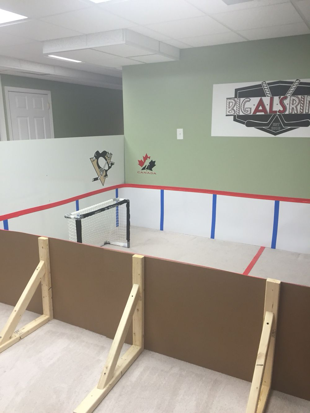 Mini Knee Hockey Rink Made By Mom Using Poster Board And Vinyl Plywood Hockey Bedroom Hockey Room Backyard Ice Rink