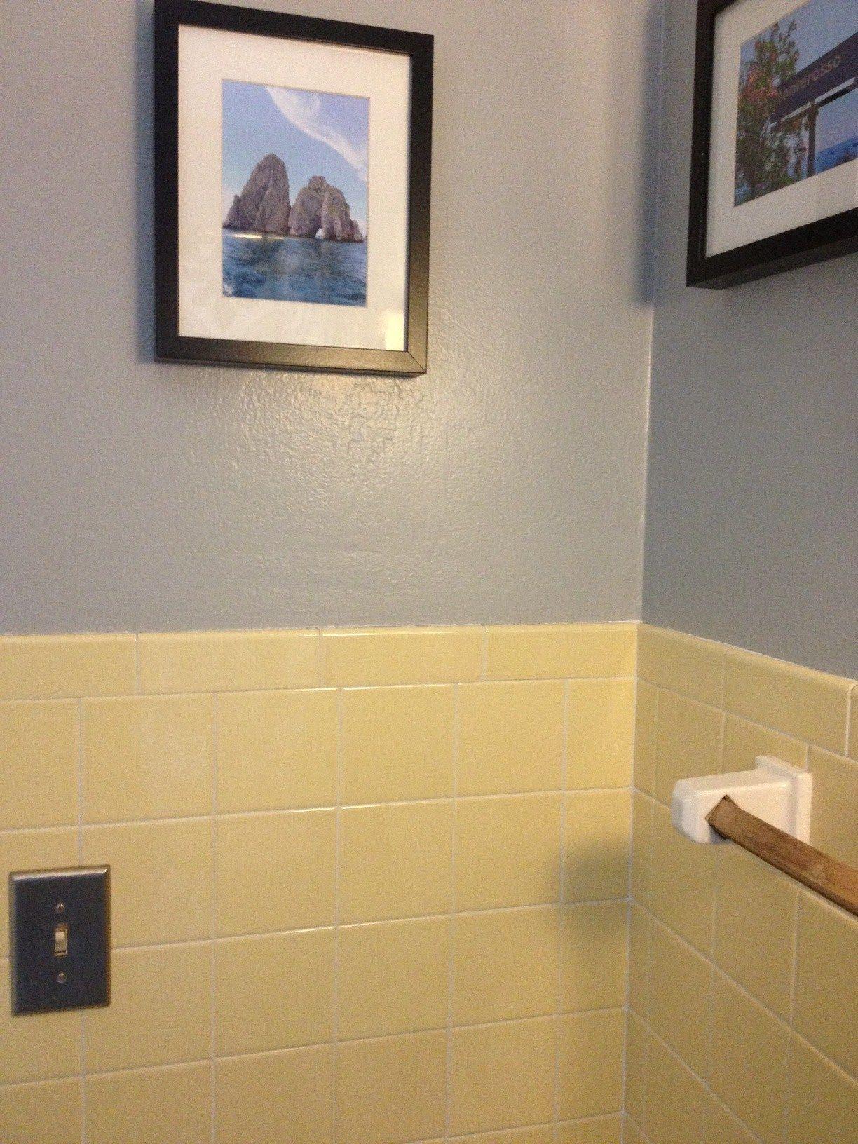 yellow bathroom tile with grey walls