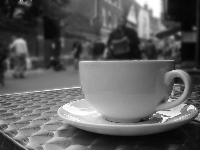 See the world from behind a coffee cup.