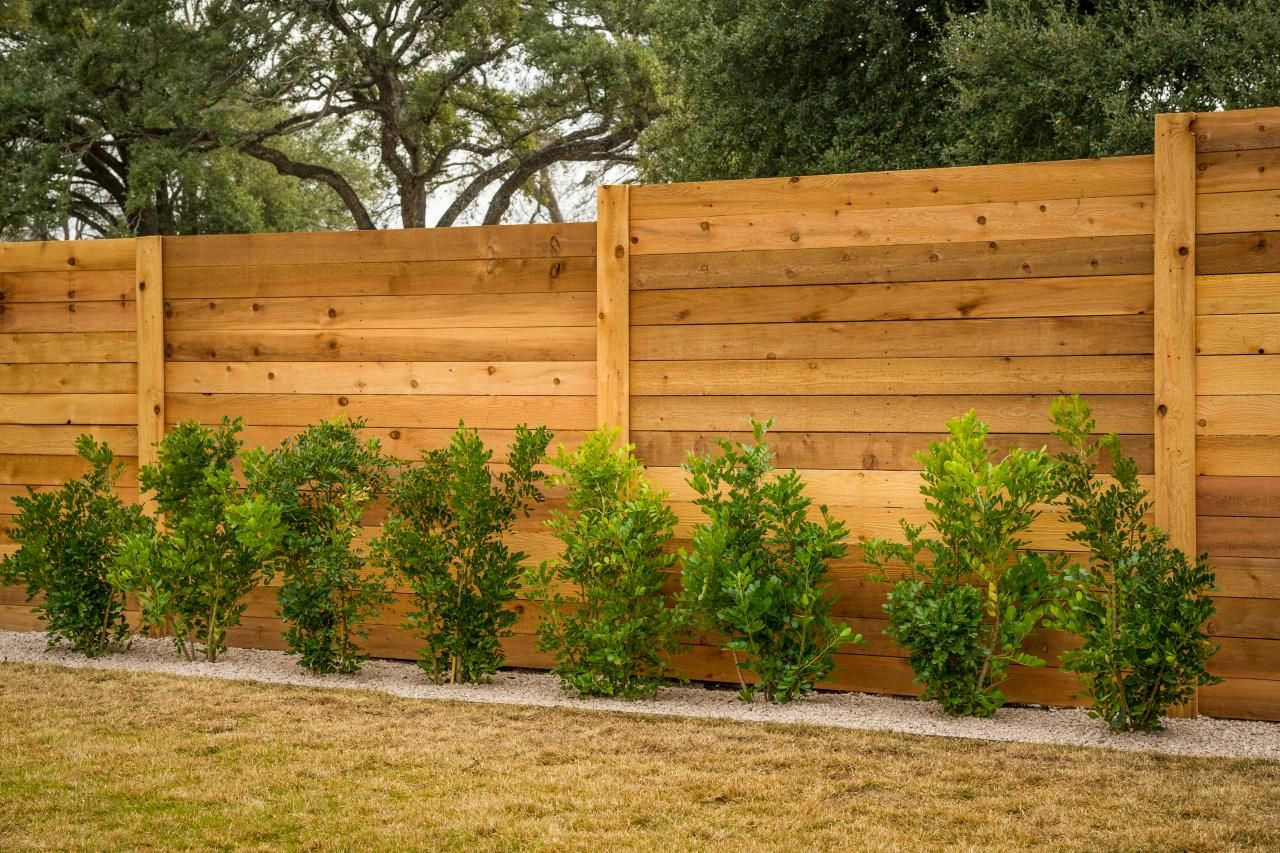 fence and bushes pictures of the hgtv smart home 2015 front yard hgtv - Garden Ideas Along Fence Line
