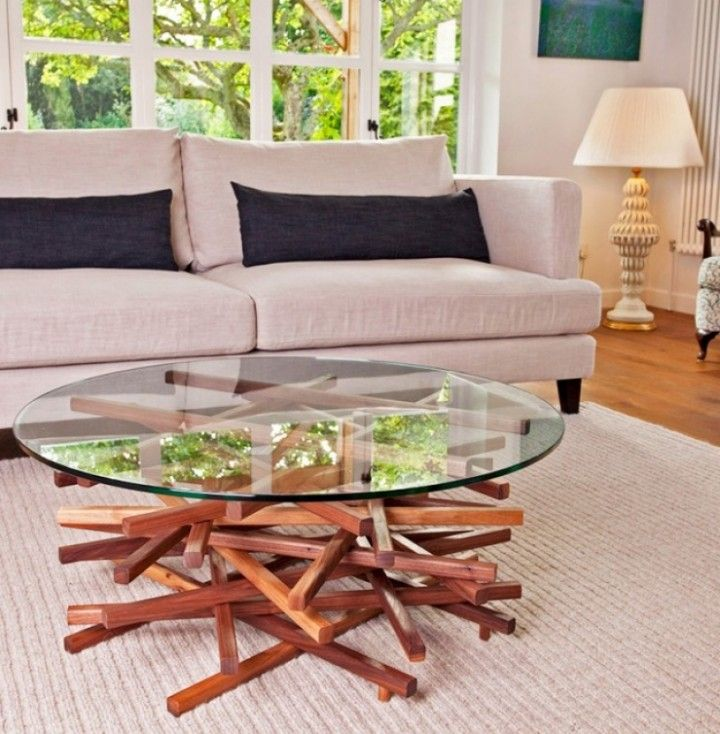 Modern wooden coffee table with a beautiful glass top #moderncoffeetables modern design #livingroomdesign coffee tables #moderndesignideas modern living room . See more inspirations at www.coffeeandsidetables.com