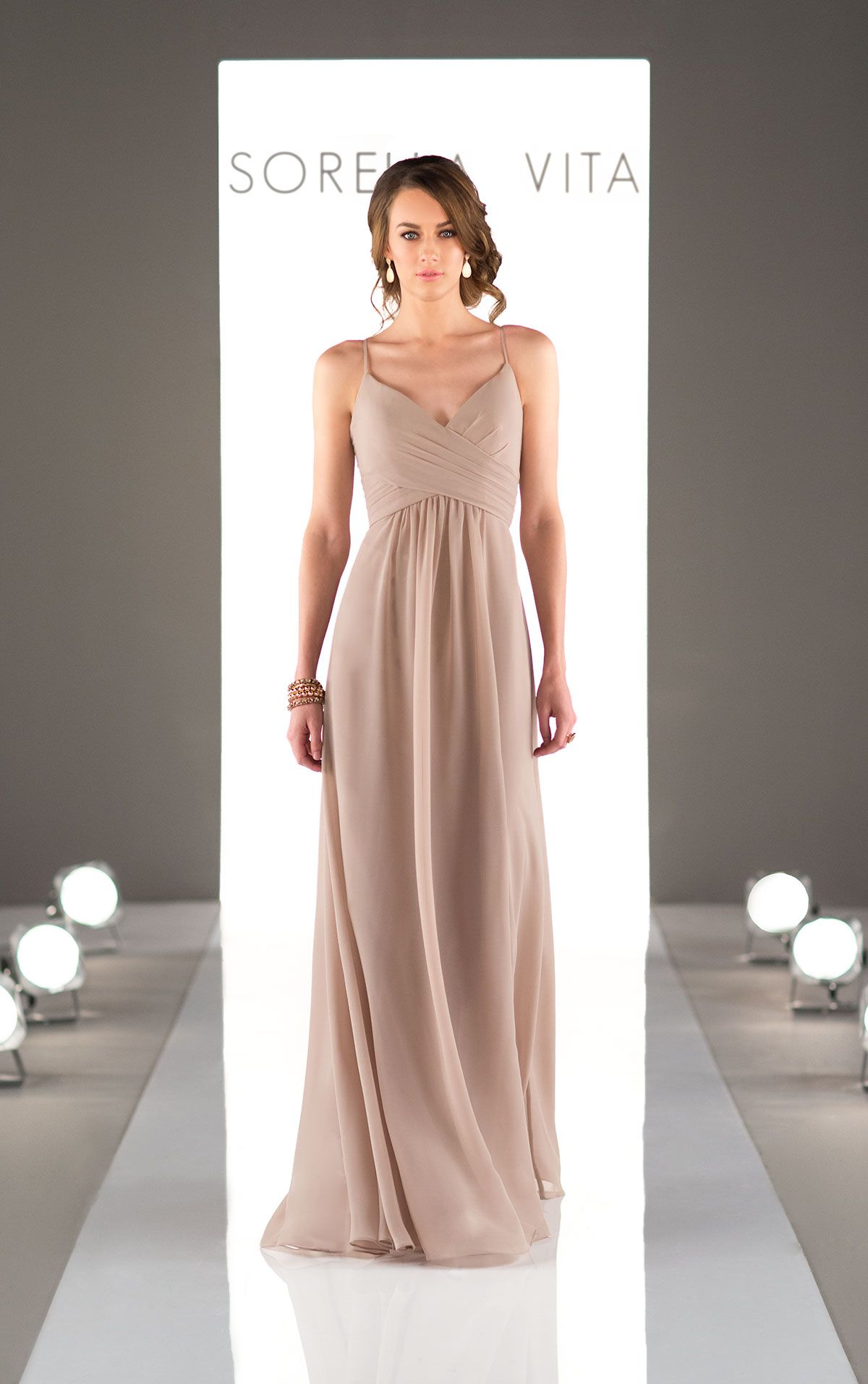 42cb2c5d89f9 A criss-cross bodice of this bridesmaid gown flows perfectly into a  floor-length chiffon skirt. Featuring a v-neck and spaghetti straps, it is  the perfect ...