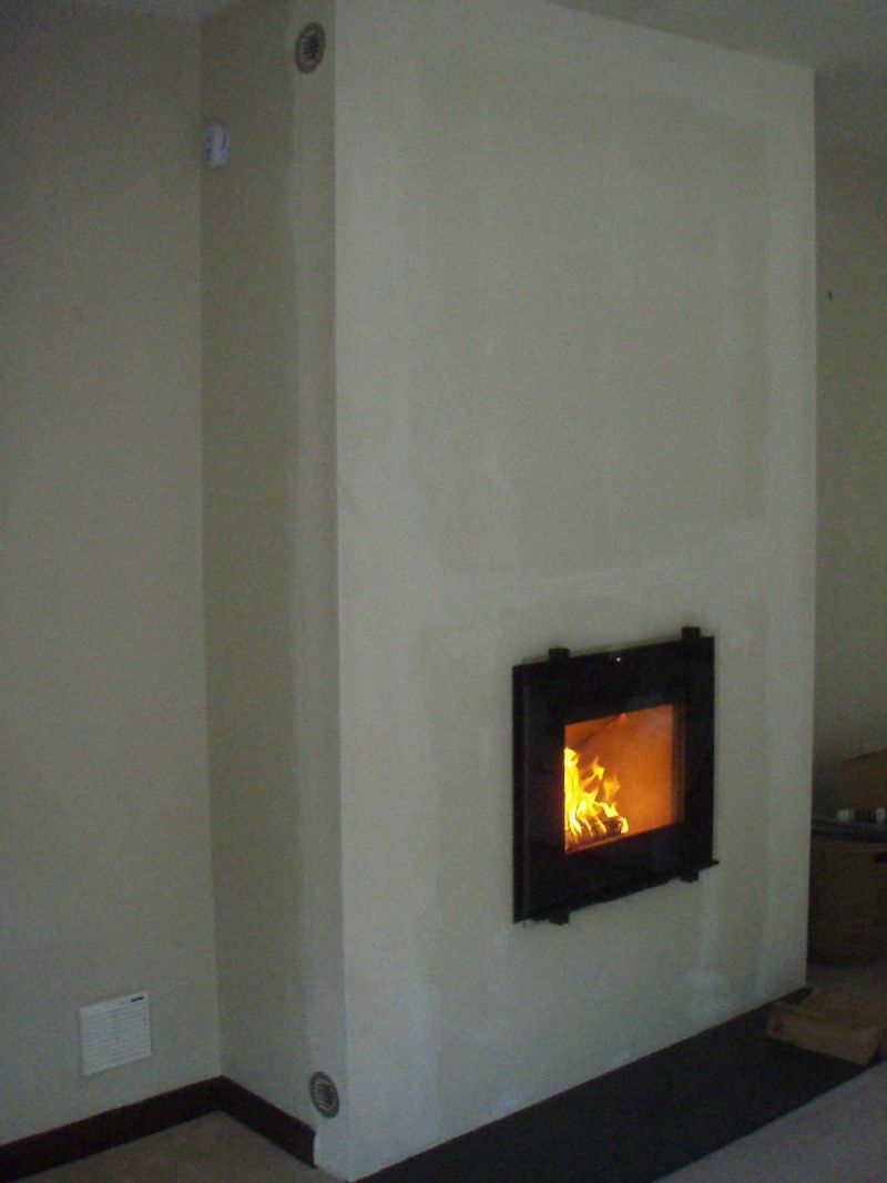 Fireplace Wall Flush Wall With Glass Tile And Metal: Hwam 30/45 With A Vertical Lift Door. #hwam #stove #fire