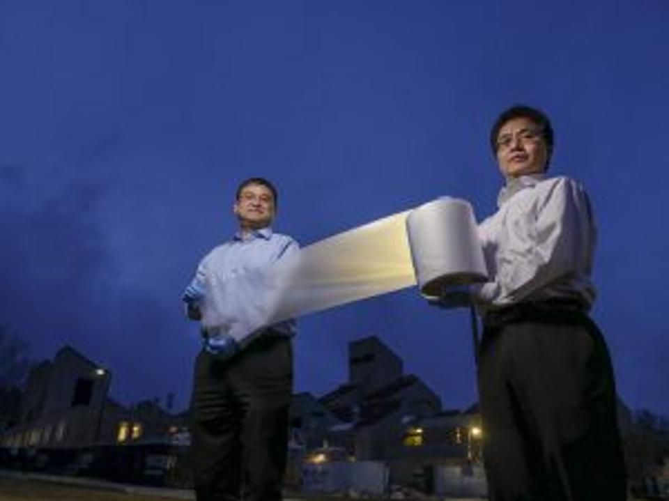 The Lead Engineers Hold The Alumunium Foil Thin Super Material Developed At The University Of Colorado Boulder The Energy Green Energy Solar Energy Solutions