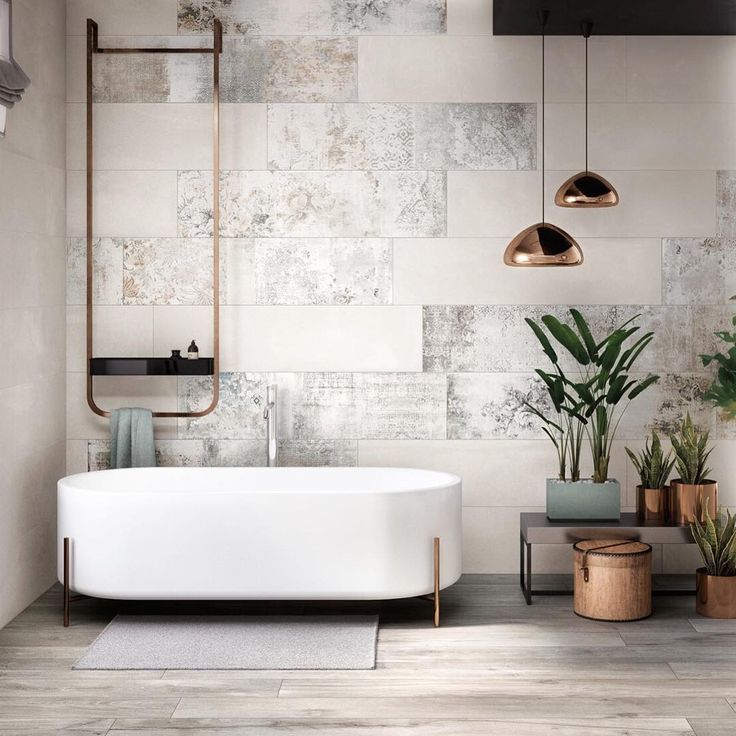 Modern Bauhaus-inspired bathroom with geometric tub, towel hanger, planters  and light fixtures