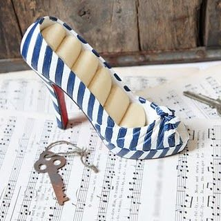A ring holder from a shoe- super cute... and you can sell the other one, too!