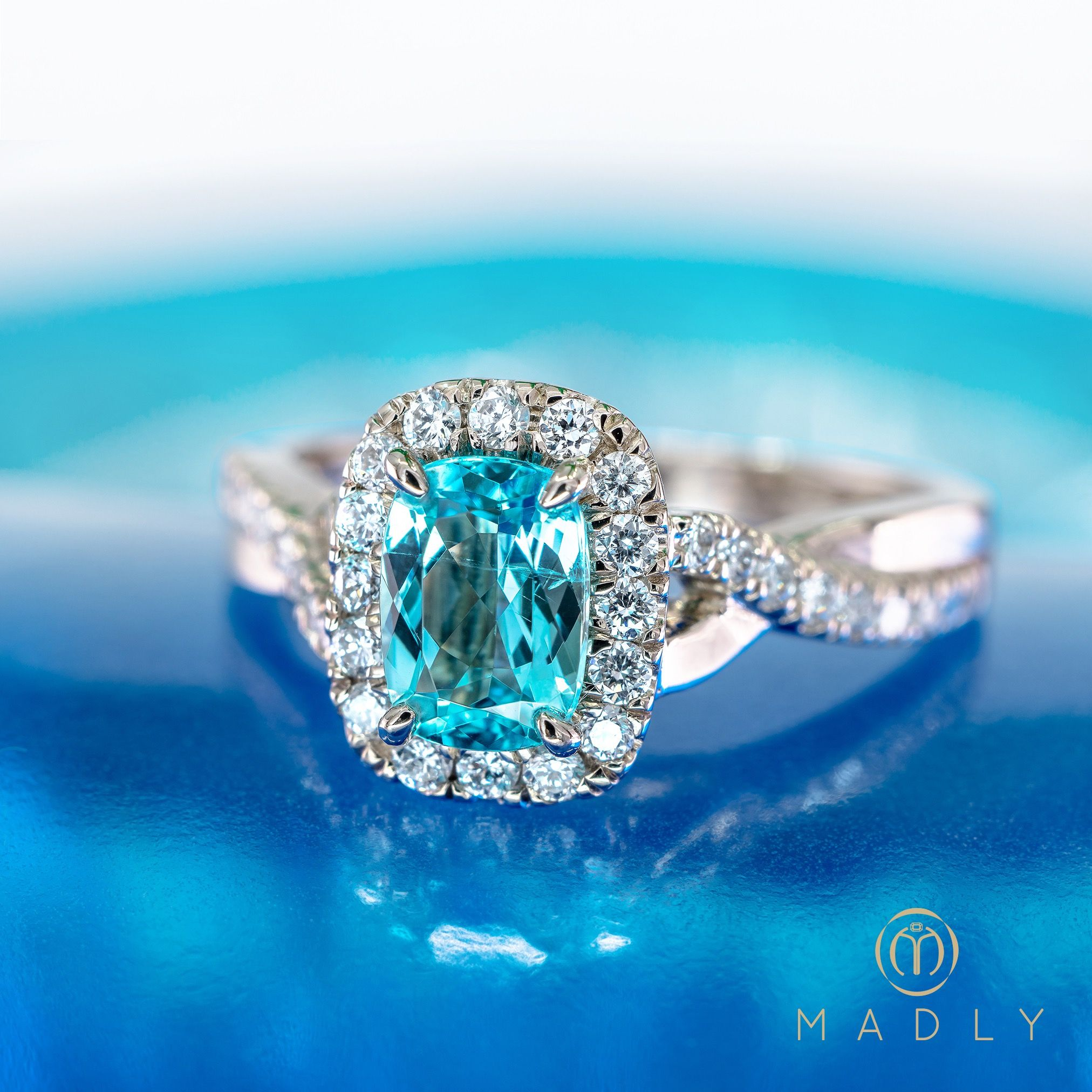 An outstanding neon blue Paraiba engagement ring by