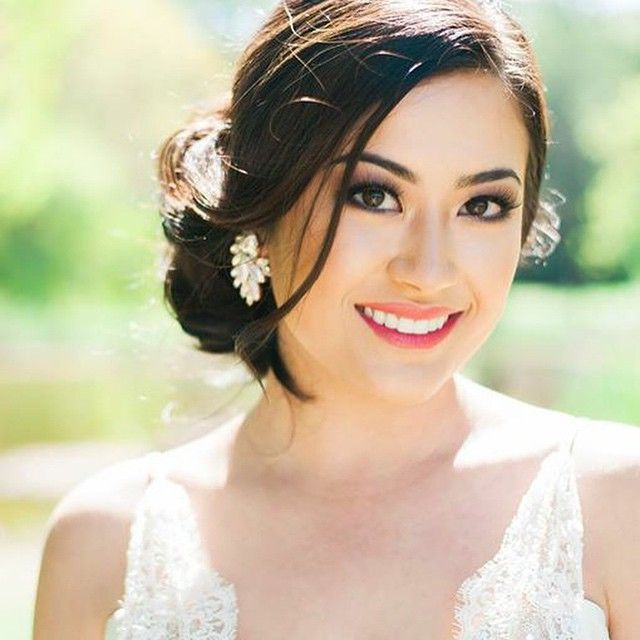 love this bride's soft sideswept updo and wedding makeup ~  we ❤ this! moncheribridals.com
