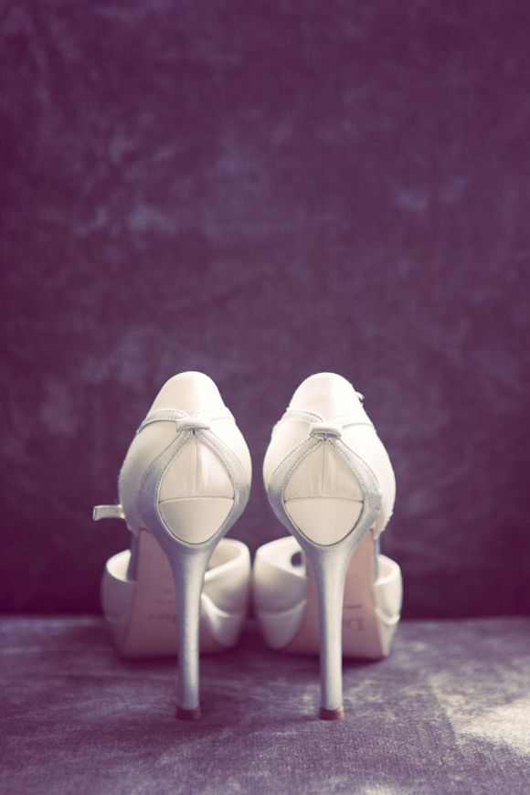 A Tiered Lace Wedding Dress And Christian Dior Shoes For An