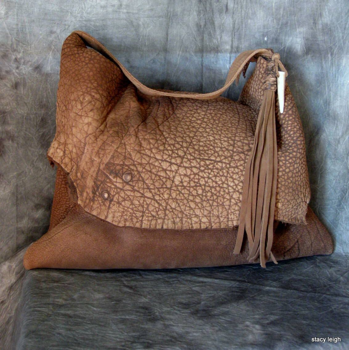 Rustic Steer Hide Leather Bag with Antler Tip by Stacy Leigh by stacyleigh on Etsy https://www.etsy.com/listing/270675655/rustic-steer-hide-leather-bag-with