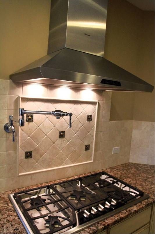 The Fretzin Family Kitchen Includes A Thermador Professional Oven And Range With Pot Filler Faucet Over Stove