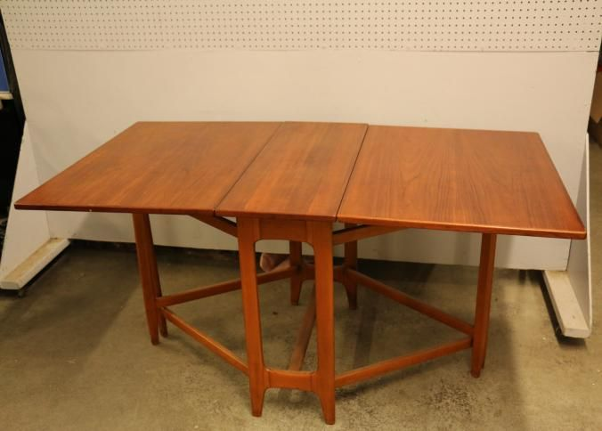 "Danish modern drop leaf table having two 25"" drop leaves 34 5"" X"