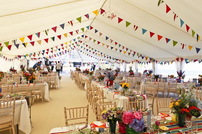 Beautiful Beach Themed Marquee Wedding Flat Ivory Linings Champagne Carpet And Lots Of Colourful Bunt Marquee Wedding Marquee Decoration Photo Booth Backdrop