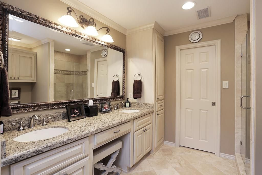 The Master Bathroom Has A Double Sink Vanity With Knee Space Fully Framed Vanity Mirror With