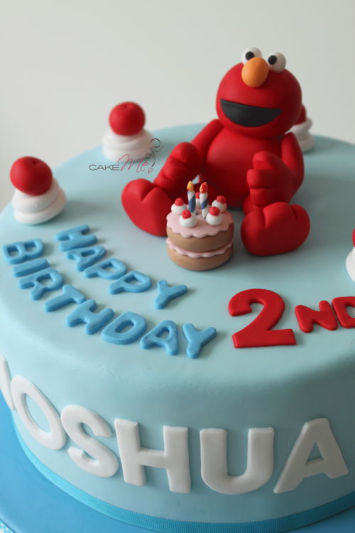 Cake Me Sesame Streets Elmo with his own birthday cake and
