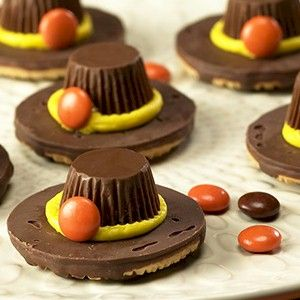 Supplies 24 Fudge Bottomed Cookies 24 Reese's Peanut Butter Cup Mineatures 24 Reese's Pieces Candies 2 Tubes Yellow Decorator's Icing (2.4 oz each) 1 Icing Tube With Decorator Tips Parchment Paper (optional)