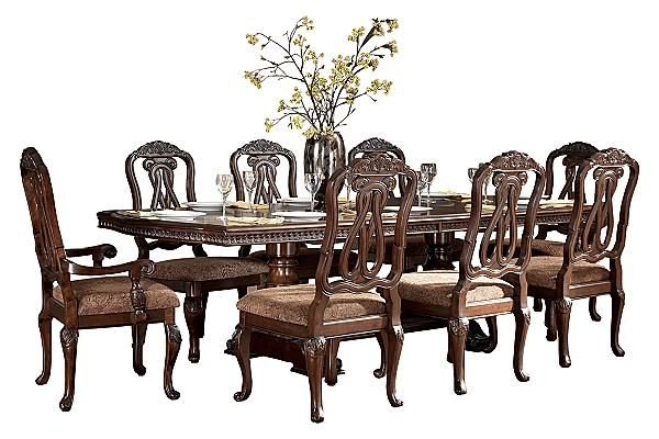 The North Shore Dining Room Extension Table From Ashley Furniture Homestore Afhs Com A Deep Rich Stained Finish Furniture Home Furniture Dining Table Chairs