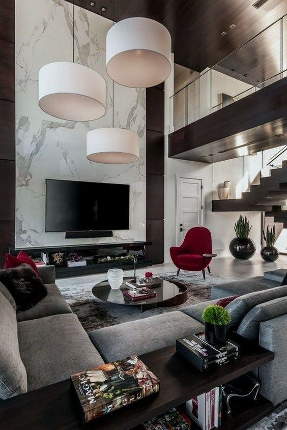 I Think The Focal Point Here Is The Big White Hanging Light Fixtures And Then I Go To The Red Ch Modern Houses Interior Luxury Living Room Home Interior Design