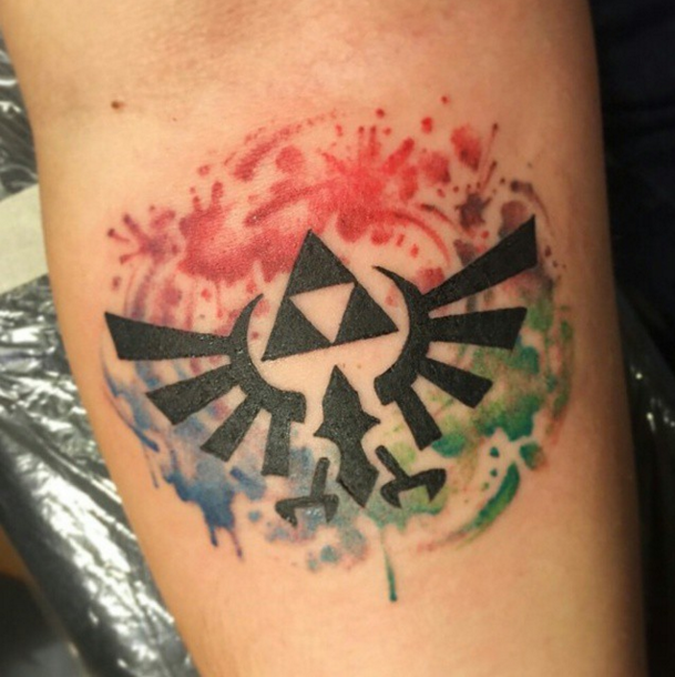100 Watercolor Tattoos That Perfectly Replicate The Medium: This Playful Triforce On Watercolor Splatters: