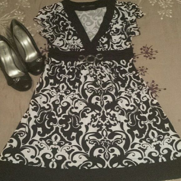 Black and white dress Floral swirl ask and white dress... 3 round circles in the middle as a belt.  Ties in the back.  Very elegant and stylish. Maurices Dresses