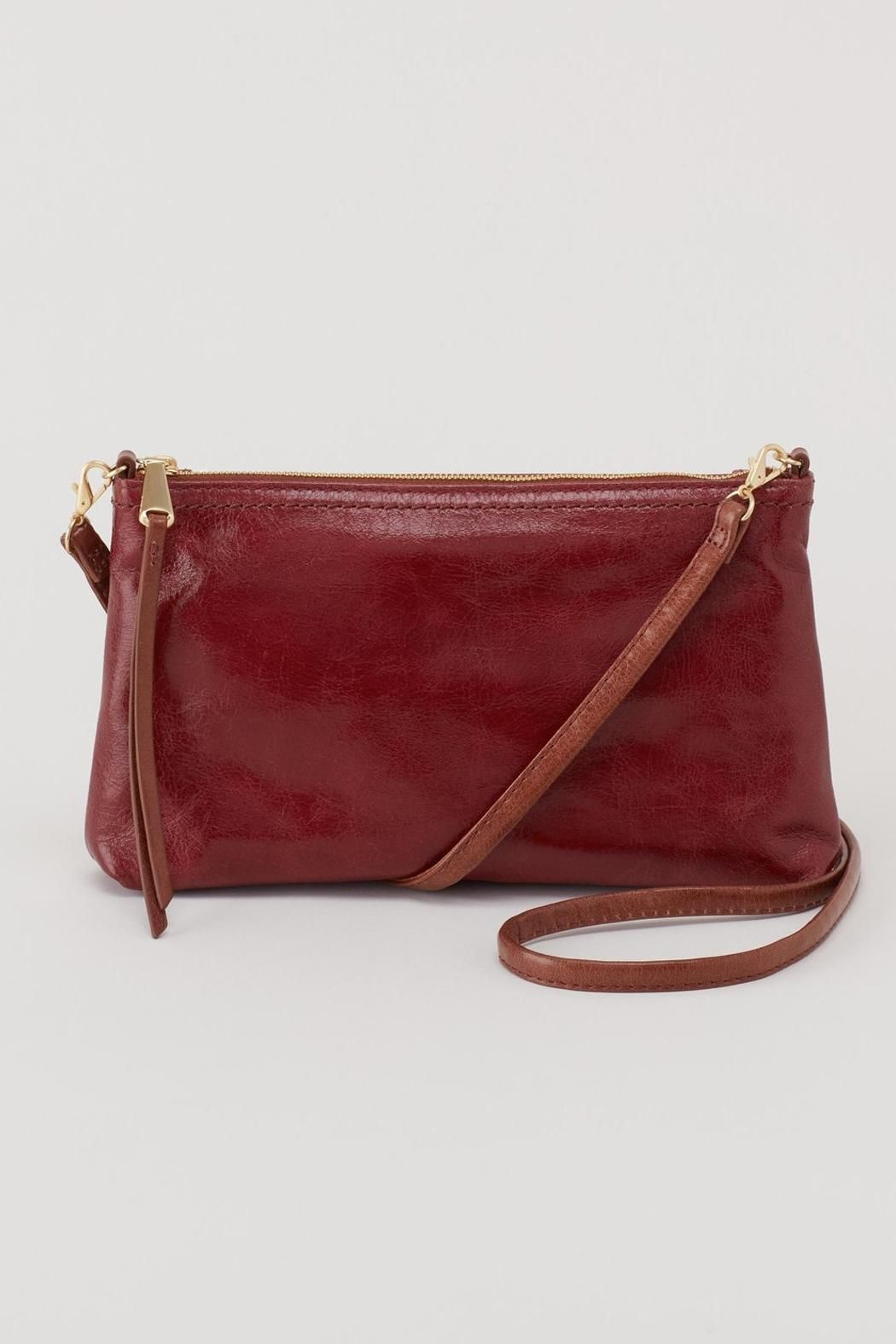 """Convertibility at its finest. Wear the Darcy as a crossbody, wristlet, or mini bag. The strap is easily convertible as well as removable. Gun metal hardware.    Dimensions:9""""W X 5""""H X 1""""D with a convertible 26"""" strap drop.   Darcy Convertible Clutch by Hobo. Bags - Cross Body California"""