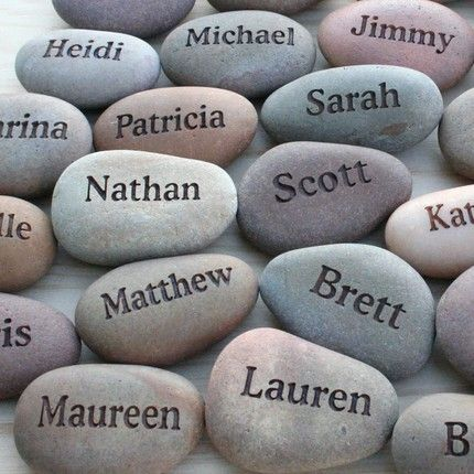 place setting idea - stones. Another idea is to use shells for name place…