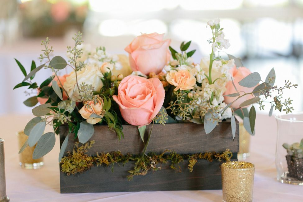 Long wood crates filled with soft pink blooms for and