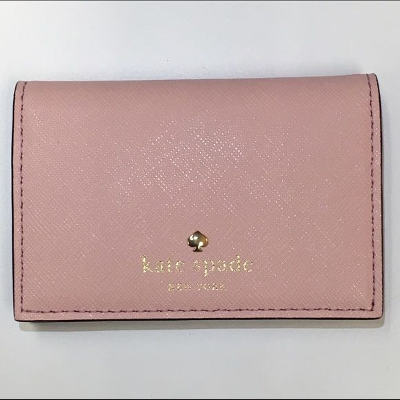 Kate Spade Card Holder BRAND NEW WITH TAGS. NEVER USED. Will ship with original plastic, care card, tag, and styrofoam inside. Cedar Street Melanie in rose jade. No trades. Price is firm unless bundled. kate spade Bags Wallets
