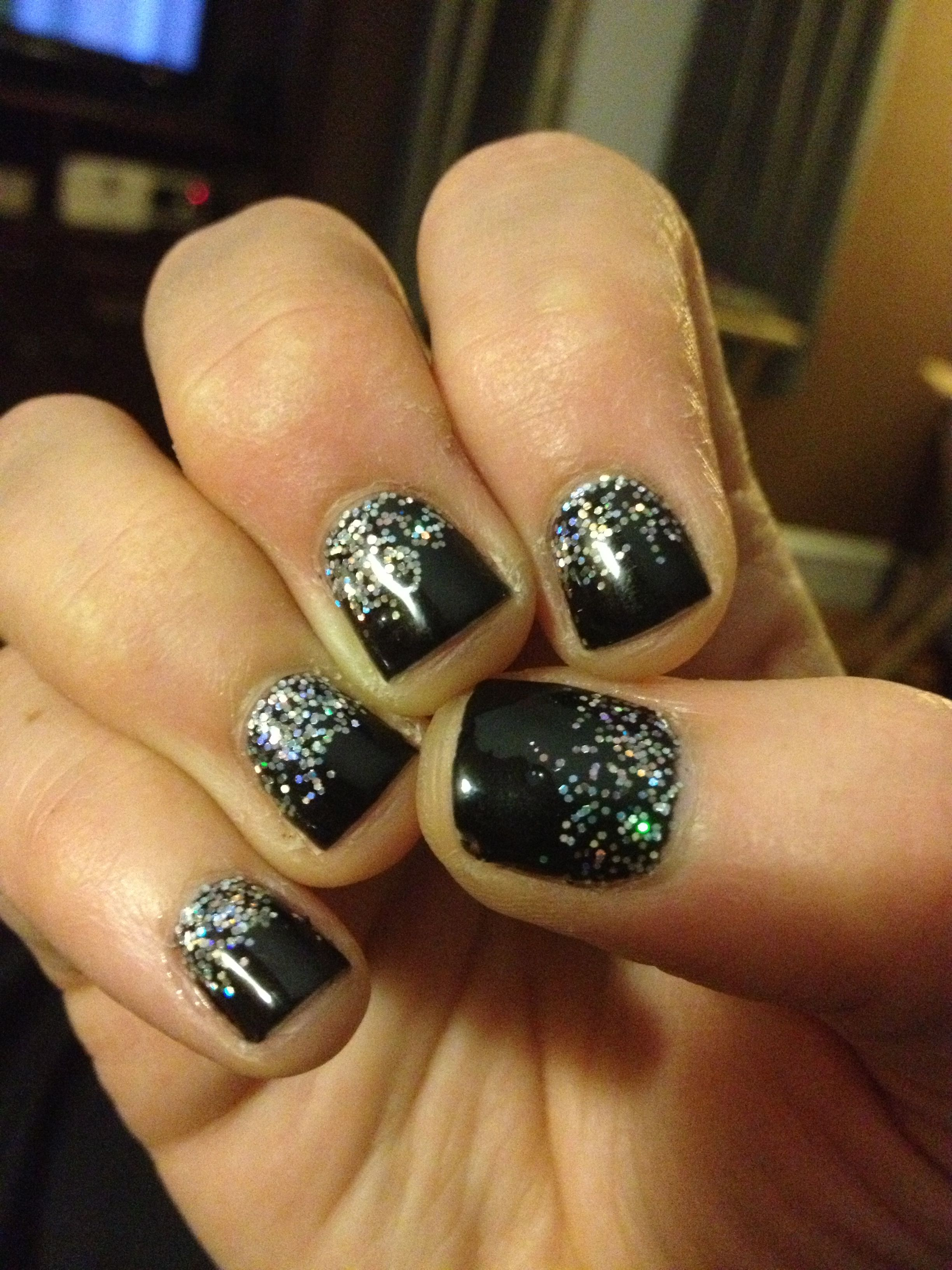 Black OPI GEL manicure w/ loose iridescent glitter applied and the ...