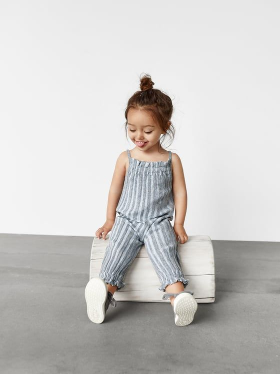 Photo of STRIPED KNIT OVERALLS